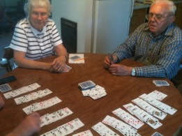 Playing canasta at the kitchen table.