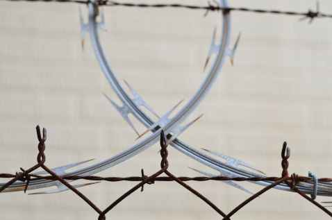 barbed wire barrier blur border